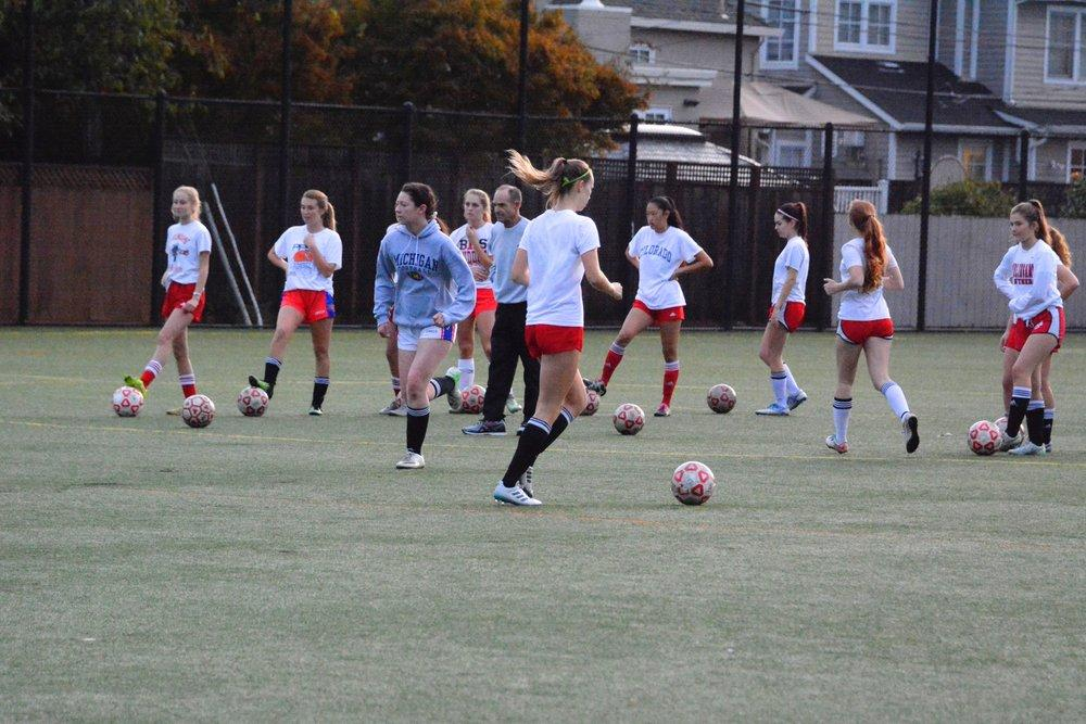 Girls varsity soccer practices for upcoming game as commitment in many sports on campus declines. (Photo by Maddie Greene)