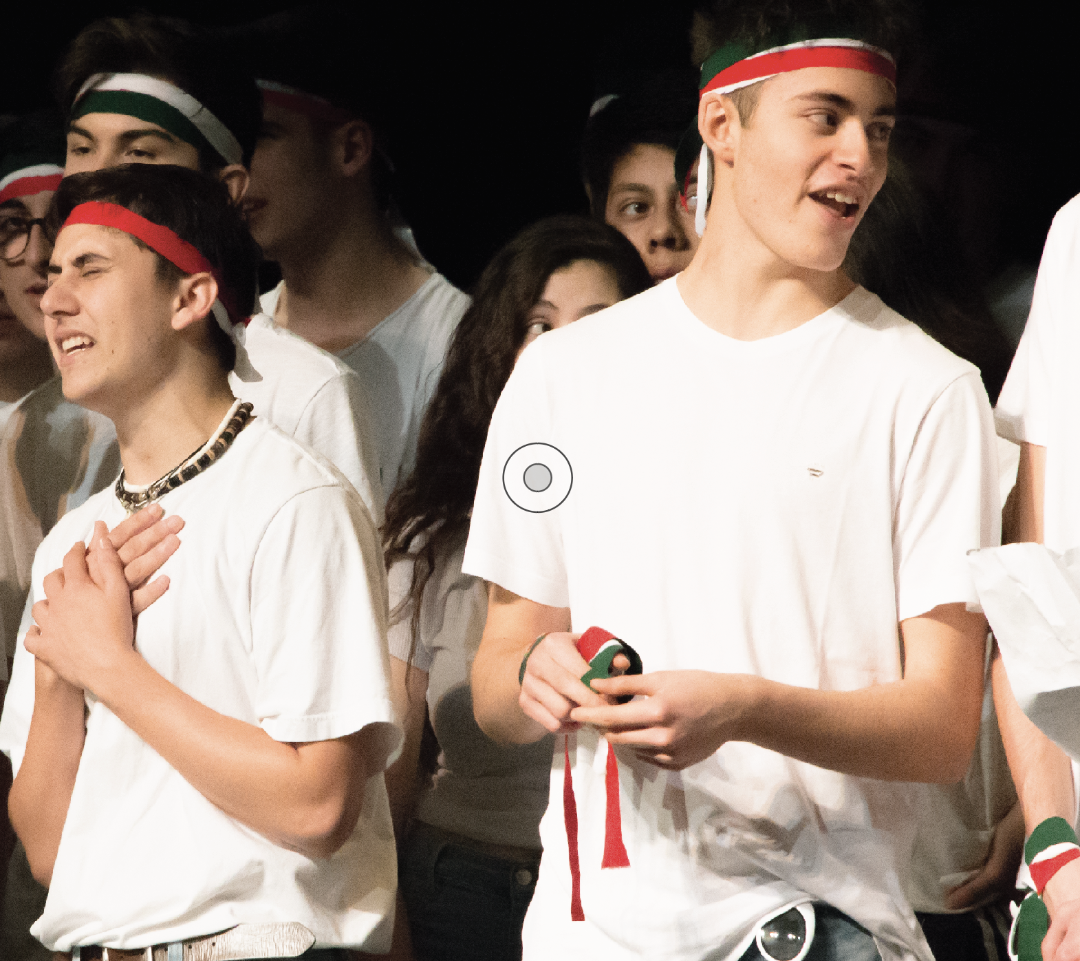 """Senior Justin Cilia (Left) and Italian exchange student Andrea Giorgio (Right) sing the Italian political song """"O Bella Ciao"""" during the International Assembly on March 20.The lyrics of the anthem honor partisans who rebelled against Nazi rule during World War II. Since then, politics have saturated Italian culture, yet a new wave of apathy has emerged in response to elections in recent years."""