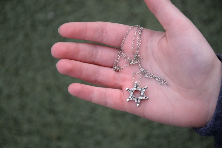 The+Star+of+David+is+recognized+as+a+symbol+of+Jewish+identity.+The+design+of+this+necklace%2C+belonging+to+freshman+Zoe+Steinberger%2C+has+a+story.+During+the+Spanish+Inquisition%2C+Jews+wore+Star+of+David+necklaces+which+could+unfold+as+butterflies+in+order+to+conceal+their+true+religious+meaning.+Steinberger%27s+necklace+is+a+modern+replication+of+this+design.