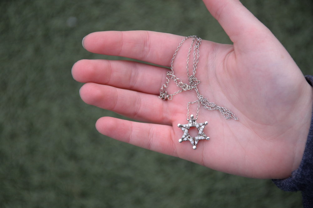 The Star of David is recognized as a symbol of Jewish identity. The design of this necklace, belonging to freshman Zoe Steinberger, has a story. During the Spanish Inquisition, Jews wore Star of David necklaces which could unfold as butterflies in order to conceal their true religious meaning. Steinberger