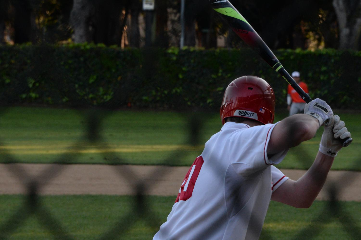 Current Junior Taylor Clark takes a cut during a 2018 game.