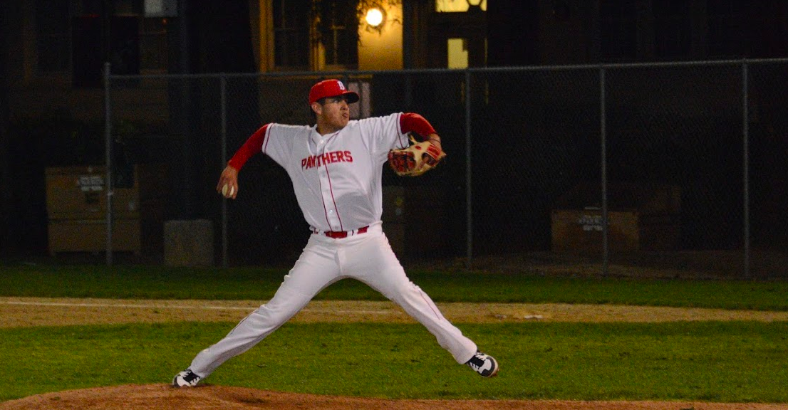 Senior Emilio Flores throws a pitch during a 5-0 win over Mills.