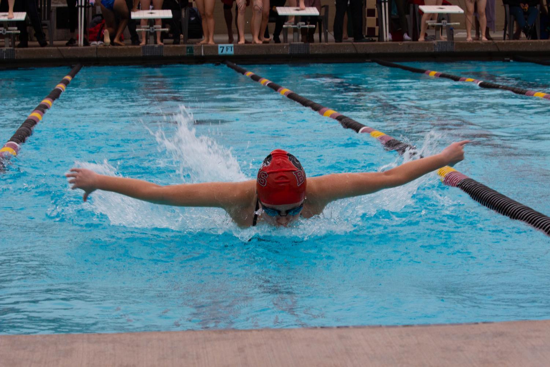 The swim team ignites their team spirit as they prepare for their swim meet against Menlo-Atherton.