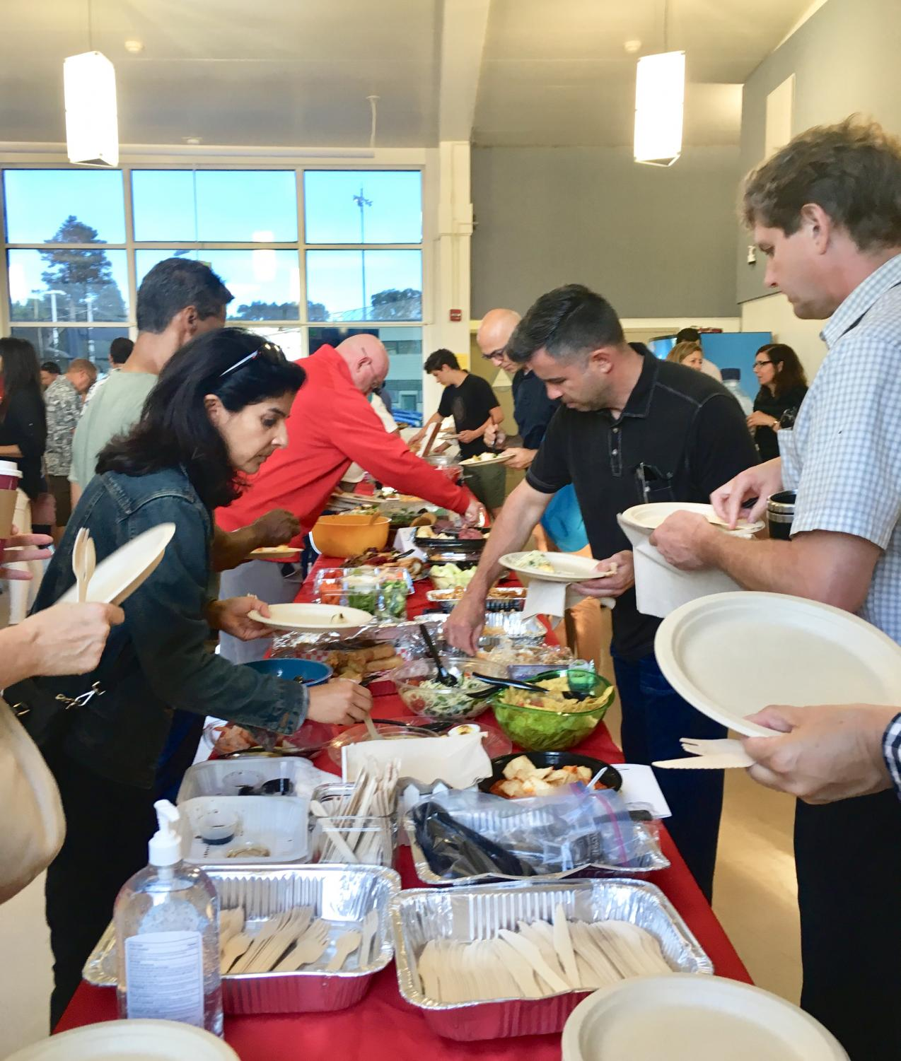 Families and teachers kick off the school year with the annual Back-to-School Potluck.