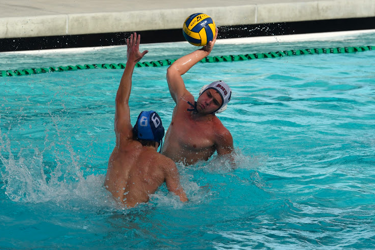 Mason Rossi challenges a defender in a matchup against Carlmont.