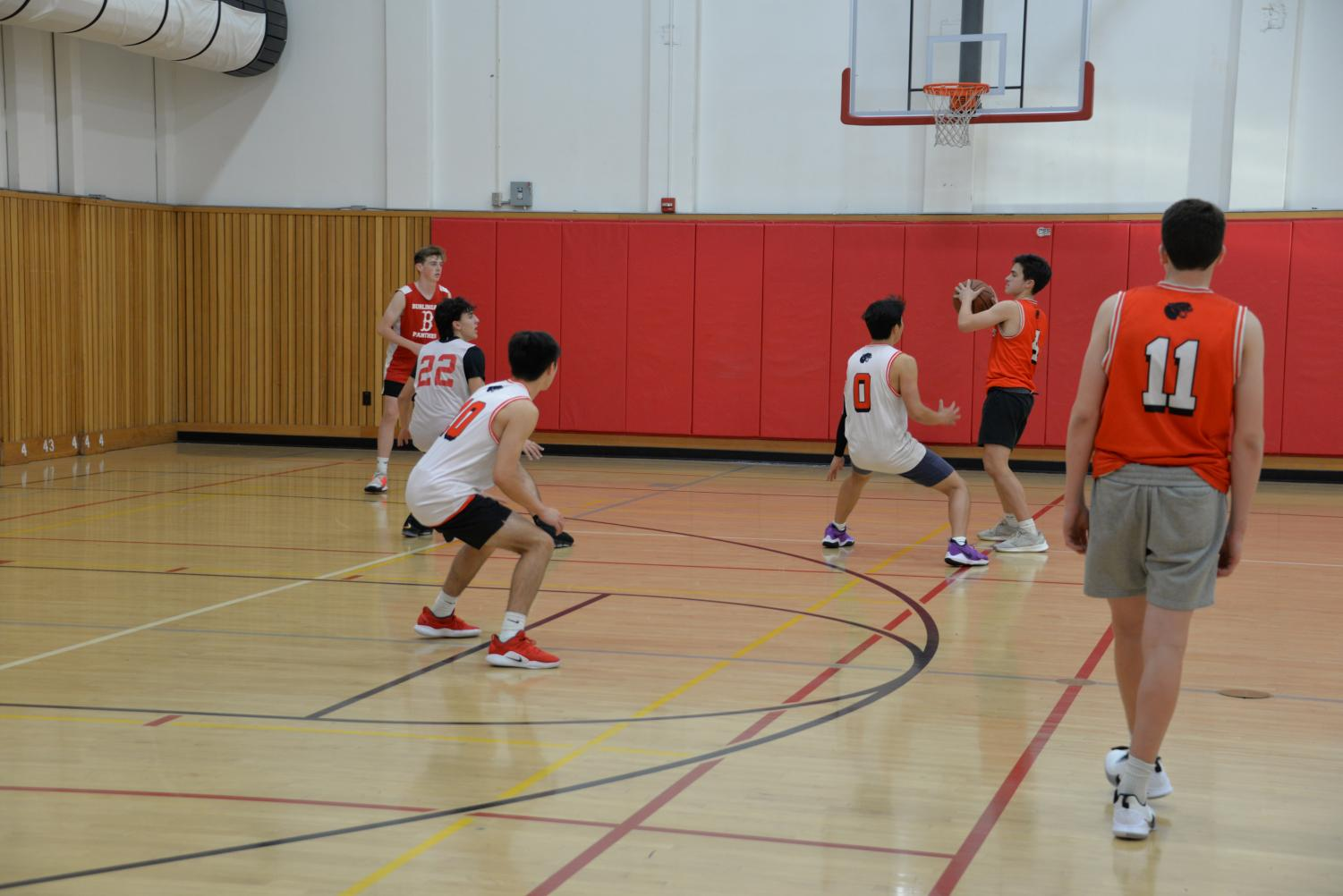 Sophomore Sean Richardson looking to make a play while being defended by fellow sophomore Jacob Yamagishi.