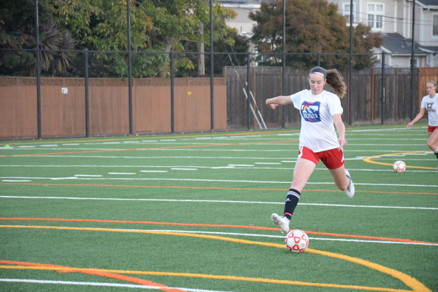 Sophomore Ella Bradley prepares to shoot during the soccer tryouts.