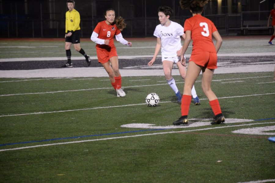 Junior Kerry Wakasa moves to defend the ball during last week's match against Woodside High School.