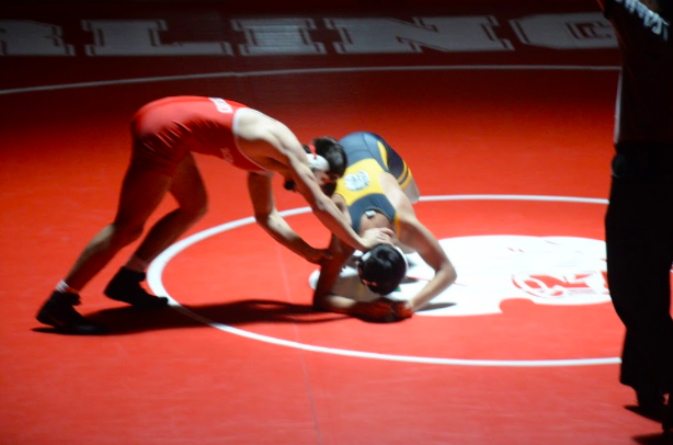 Kyle Botelho pushes his opponent away as Burlingame hosted Terra Nova in a dual meet.