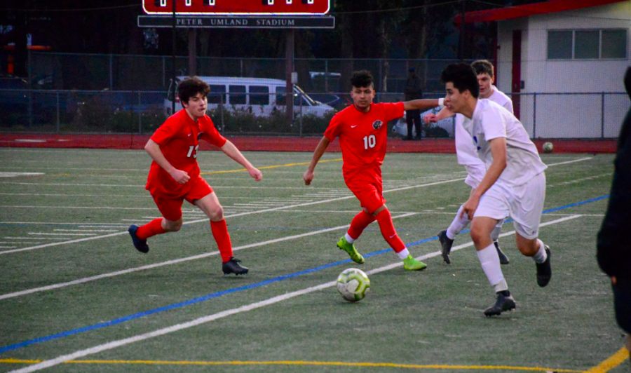 Andrew Morales and Reece Testa chase down the opponent to steal the ball.