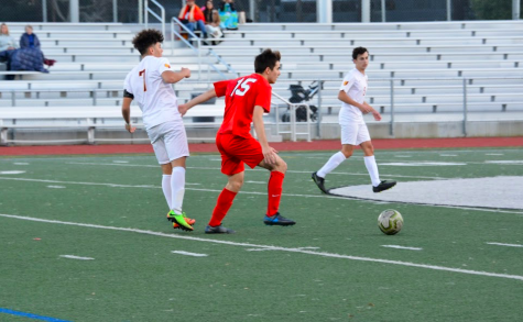 Senior Slater Bolstad possesses the ball against Menlo-Atherton on senior night.