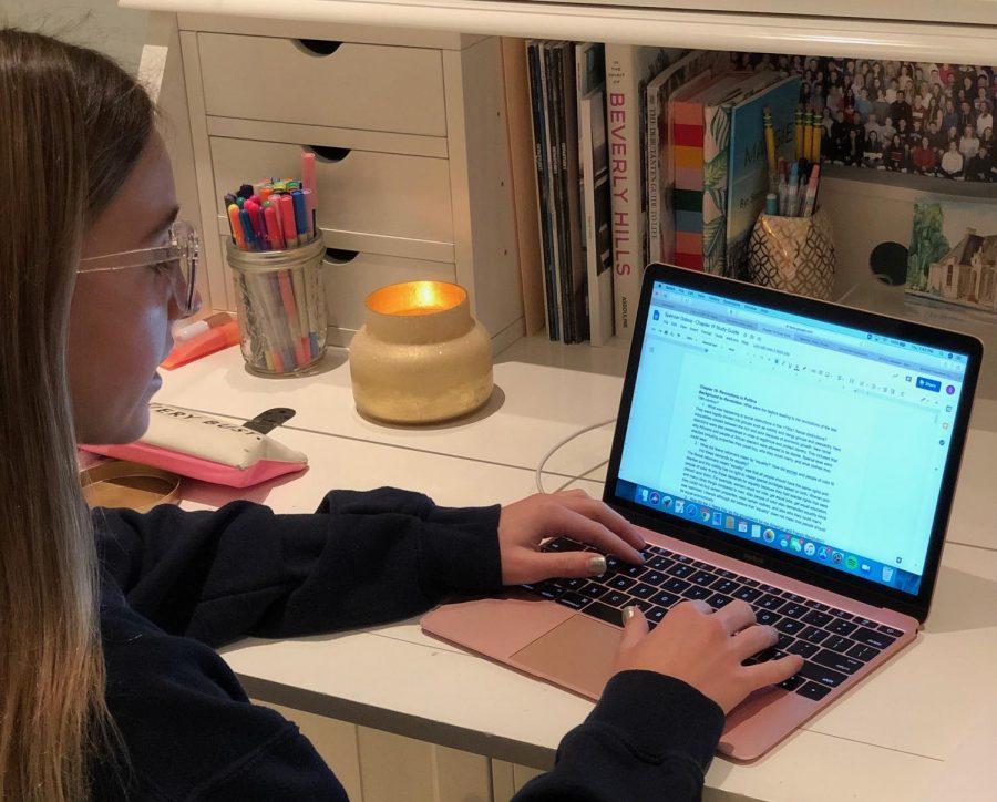 Sophomore Spencer Dobos wears her blue light glasses while doing homework.