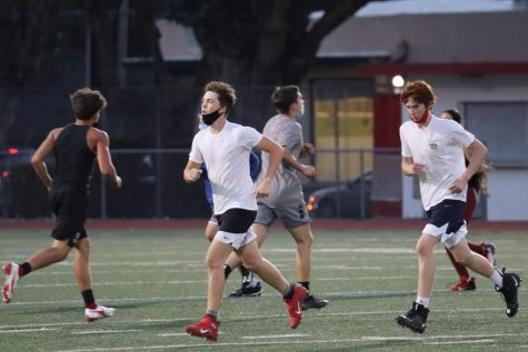 BHS's junior varsity football team sprints during a conditioning practice on Dec. 2.