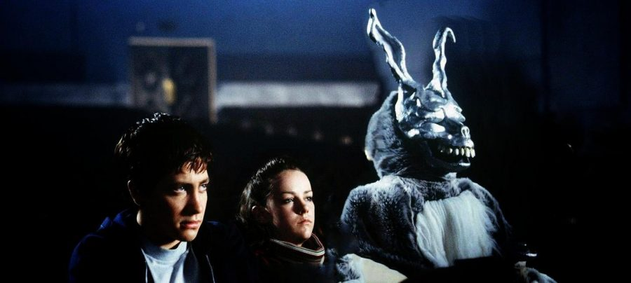"A scene from ""Donnie Darko"" where Donnie is being visited by Frank, a satanic bunny-like figure, at a movie theatre."