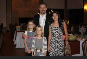 Julianna Oliver (front), age 7, stands with other church members at church mass.