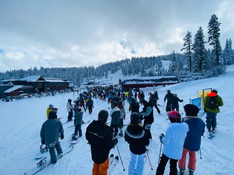 "A large crowd of skiers waits for the ski lift at Northstar's ""Tahoe Zephyr Express"" on Jan. 29."
