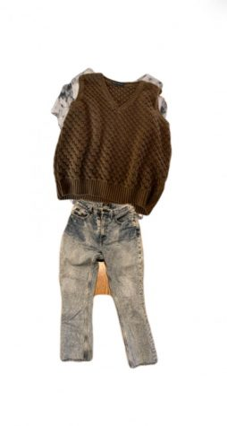Layering a sweater vest over a patterned shirt paired with acid wash jeans is a fun way to combine all the upcoming '80s trends.