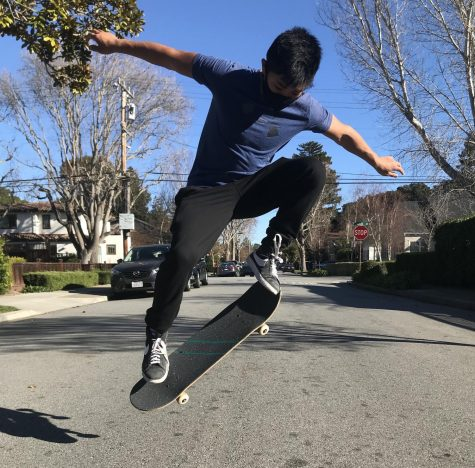 Sophomore and new skater Kai Louie Badua practices his ollie out on the Burlingame streets.