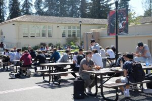 At lunch, students remained distant while talking with friends.