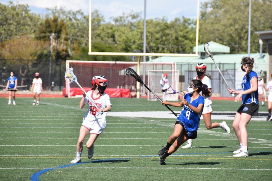 Sophomore Elise Ehrhardt races down the field as she cradles the ball.