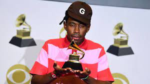 Tyler, the Creator at the 2020 Grammys with his award for Best Rap Album.