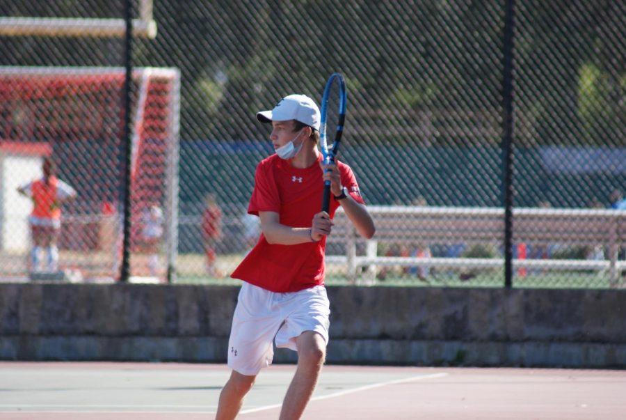 Freshman Arda Inegol participates in a singles match that he won 6-3, 6-4  against Hillsdale High School.