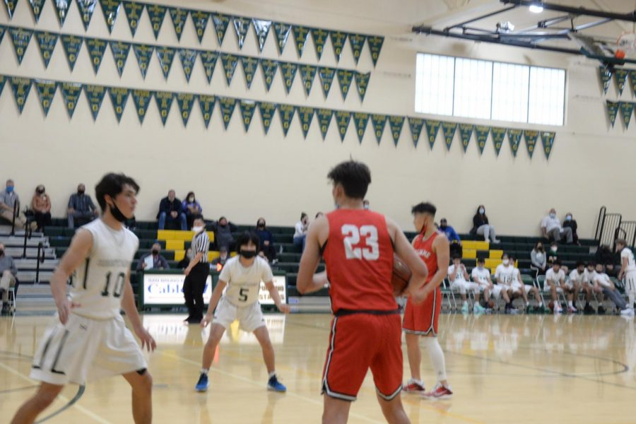 Sophomore MJ Dowd handles the ball in the Boys Varsity game against Capuchino.