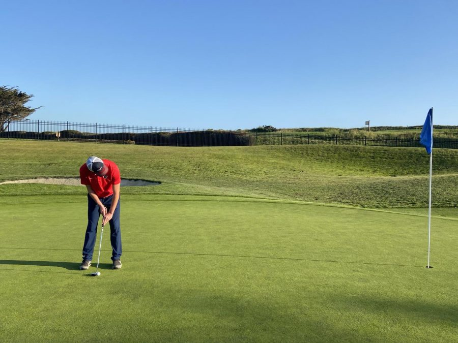 Junior Will Mendell putting at his match in Half Moon Bay on Tuesday, May 4.
