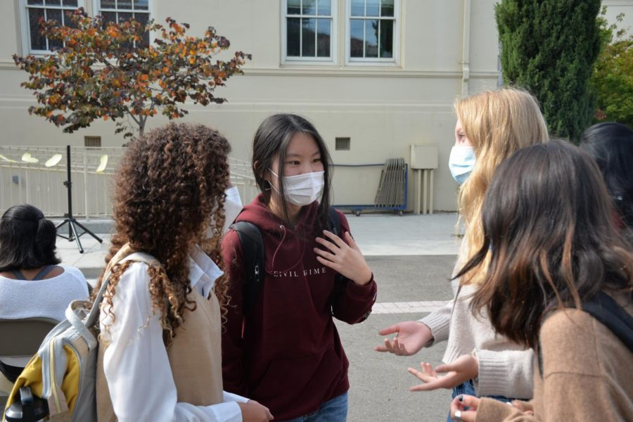 Cabinet members Lexie Levitt, Cindy Wu, Carly Peters and Natalie Gyde (left to right) confer ahead of the second student council meeting on Oct. 5.